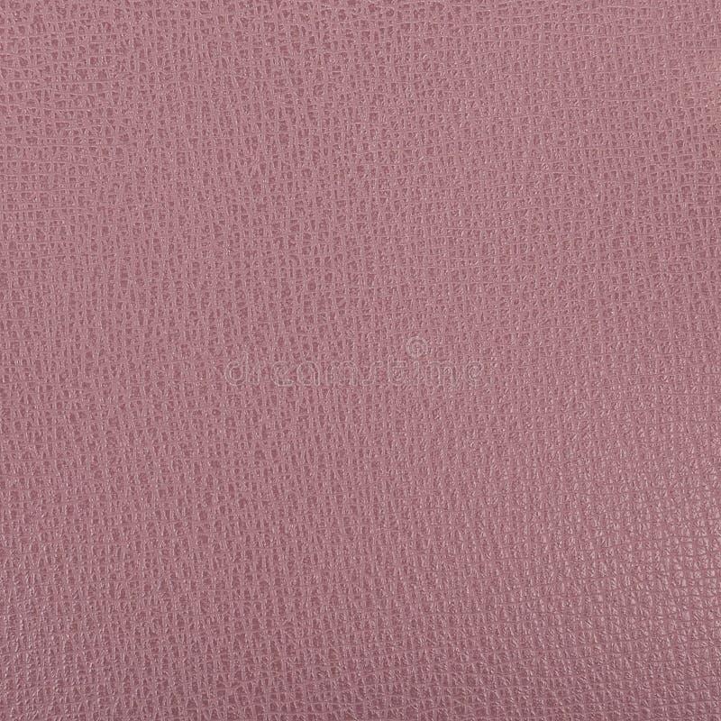 Un pedazo de primer intenso de la textura del cuero artificial de la lila foto de archivo