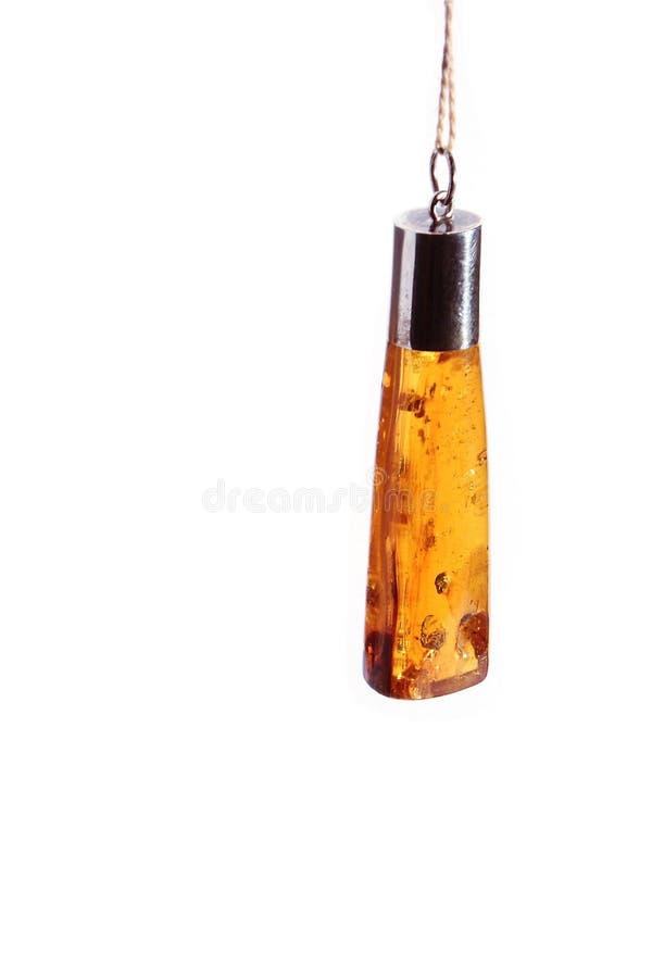 Un pendente ambrato fotografie stock libere da diritti