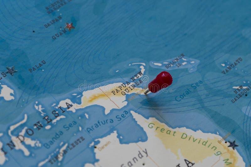 Un perno su Port Moresby, Papuasia Nuova Guinea nella mappa di mondo fotografia stock