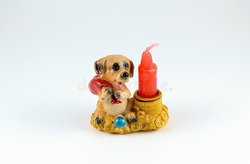 Un perro de la vela del regalo fotos de archivo