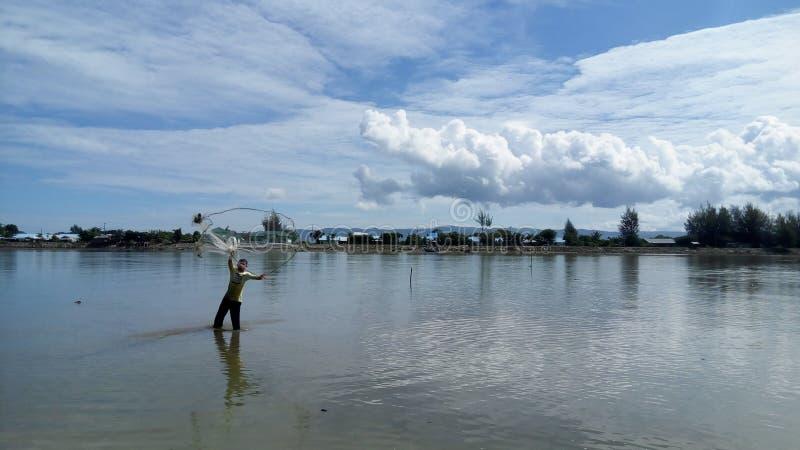 Un pescador fotos de archivo