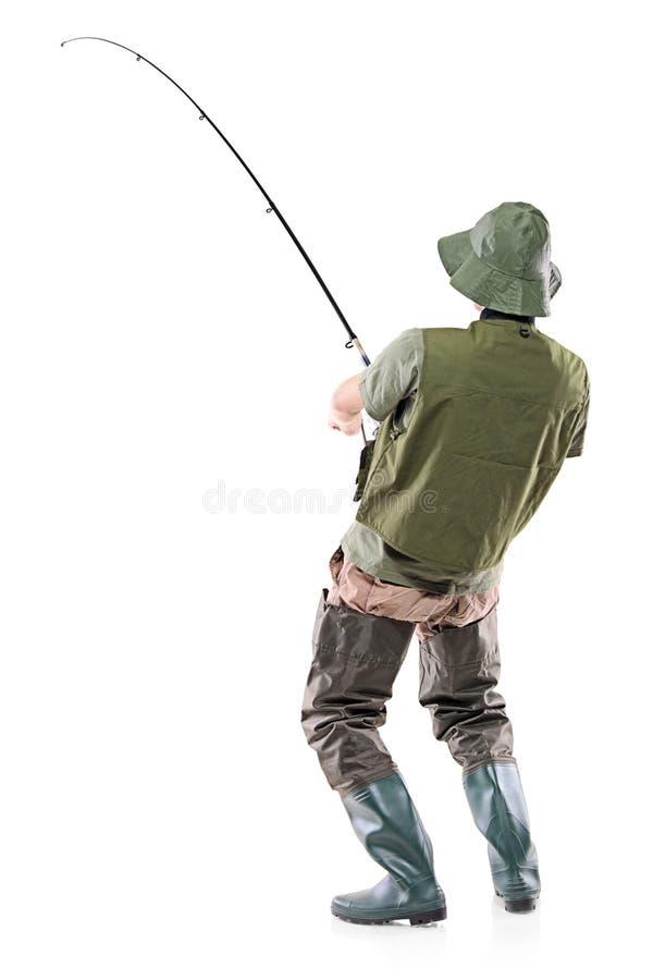 Un pescador eufórico joven foto de archivo libre de regalías