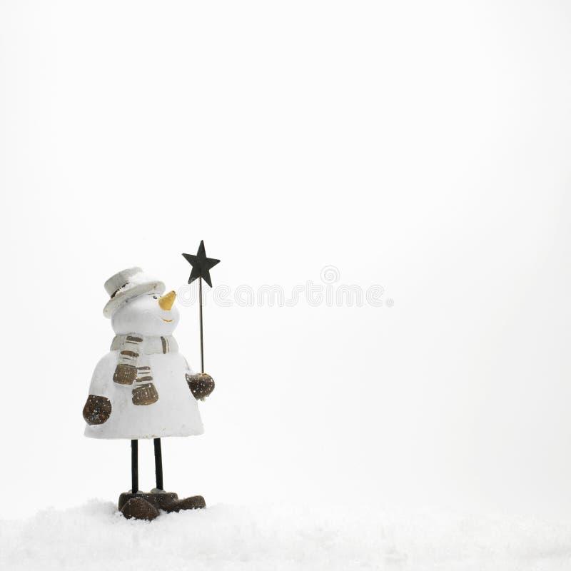 Un petit, bonhomme de neige isolé photos stock