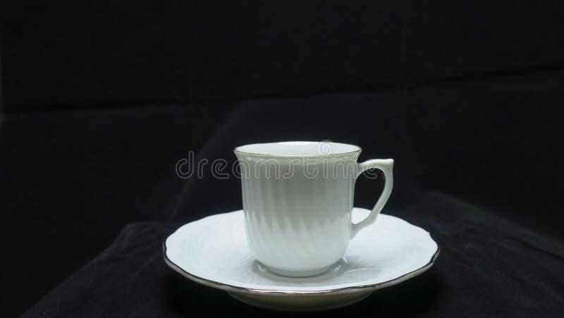 Un petit, en forme de cuvette récipient pour boire de, typiquement ayant une poignée photographie stock libre de droits