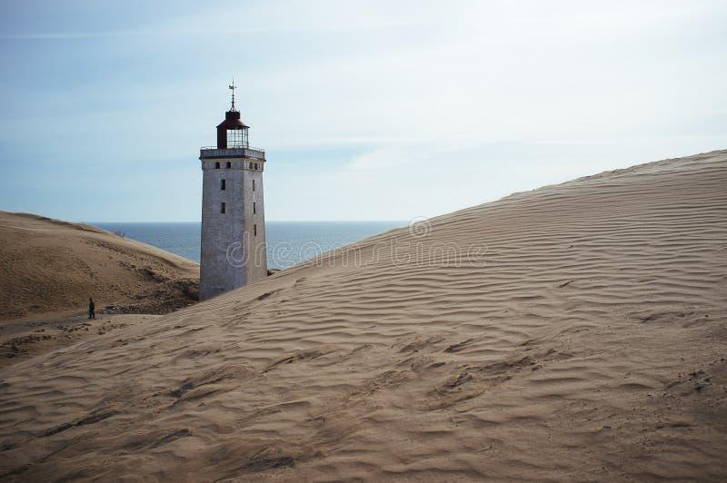 Un phare envahi par un sable migrateur dans Rubjerg Knude Danemark photos stock