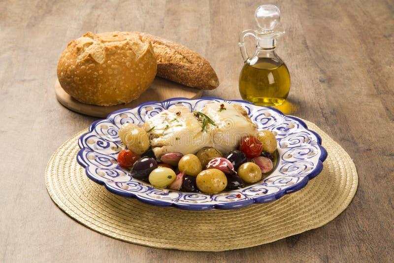 Un piatto portoghese tipico con Bacalhau chiamato merluzzo fa Oporto immagini stock libere da diritti