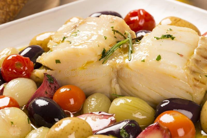 Un piatto portoghese tipico con Bacalhau chiamato merluzzo fa Oporto fotografie stock