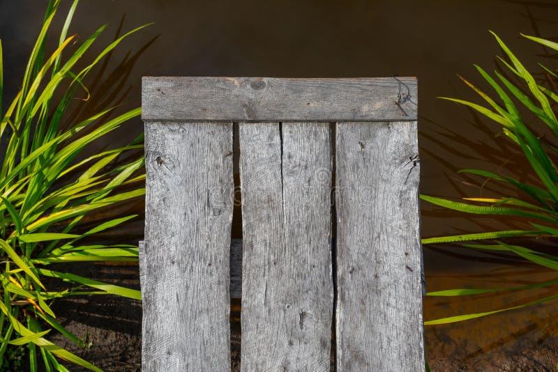 Un pilier et une eau en bois Vue supérieure image libre de droits