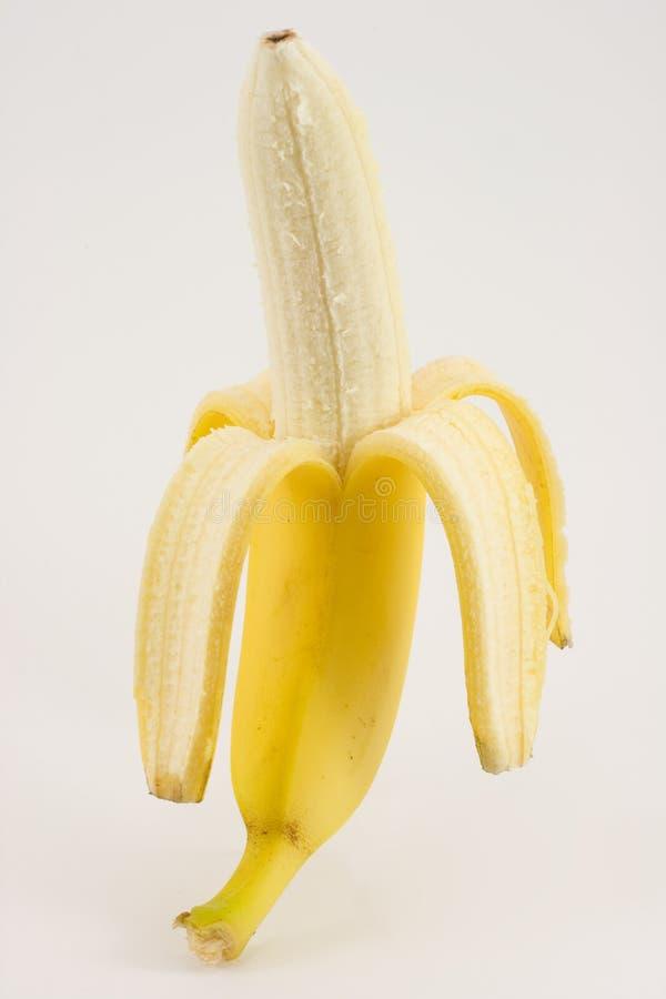 Un plátano aislado en blanco imágenes de archivo libres de regalías