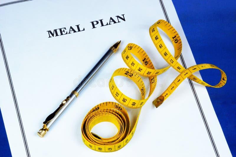 Un plan de la comida es una dieta ideal Un sano forma de vida-a monitor el contenido calórico de los productos y del peso corpora foto de archivo libre de regalías