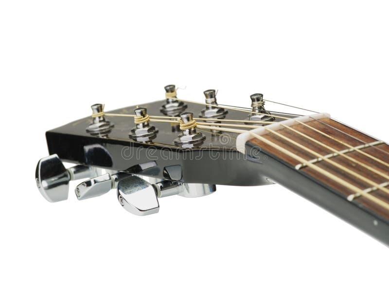 Un plan rapproché d'une poupée de guitare d'isolement sur le fond blanc Détails pour des instruments de musique Copiez l'espace photographie stock libre de droits