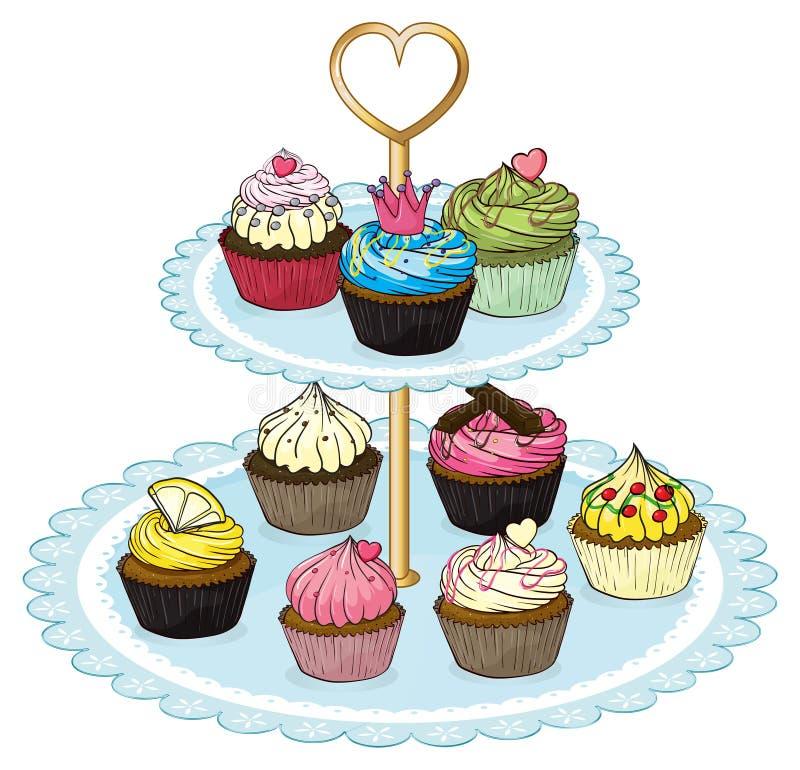 Un plateau de petit gâteau complètement des petits gâteaux illustration stock