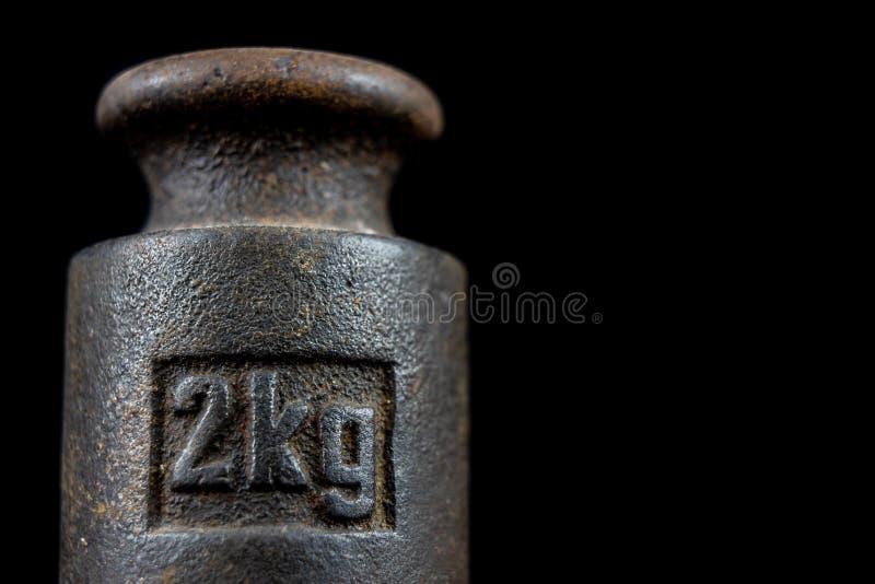 Un poids de kilogramme utilisé pour peser une quantité donnée dans le stor photos stock