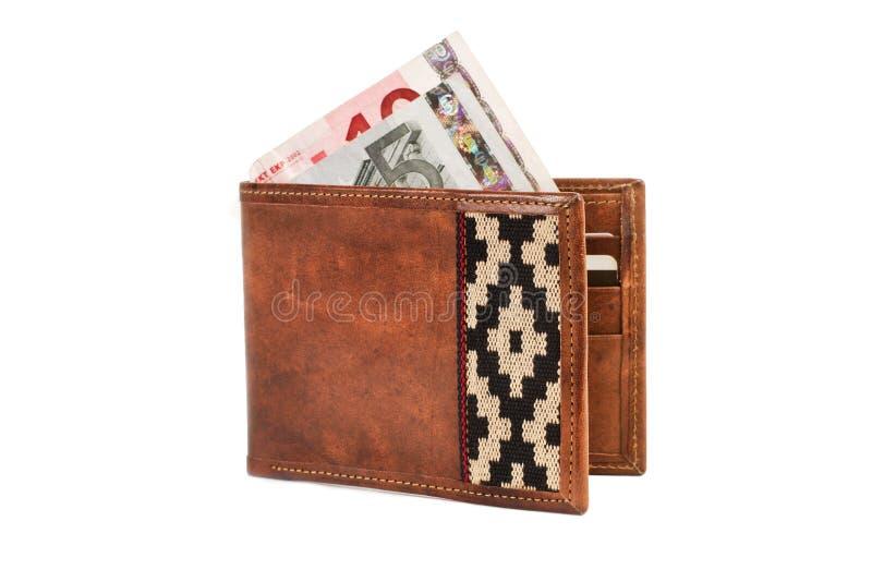 Un portafoglio di cuoio e banconote fotografie stock libere da diritti
