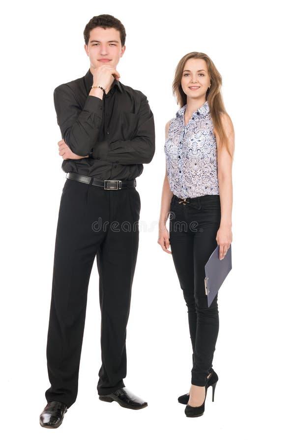 Un portrait d'une femme d'affaires et d'un homme d'affaires se tenant dedans complètement photos libres de droits