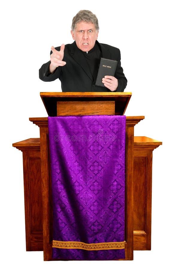 Le prédicateur fâché, ministre, pasteur, sermon de prêtre est photographie stock libre de droits