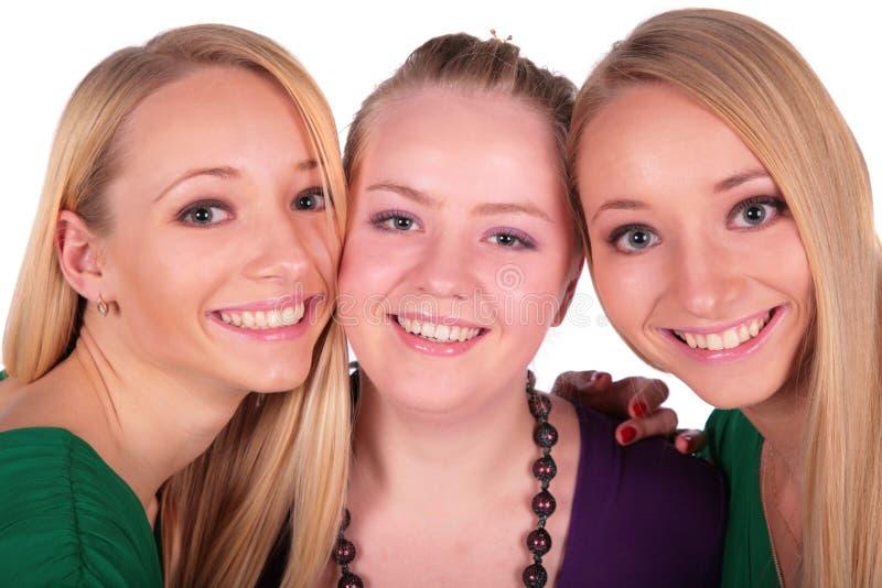 Un primo piano dei tre fronti delle ragazze fotografia stock libera da diritti