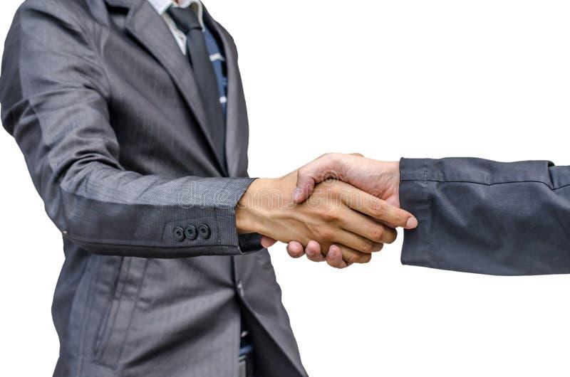 Un primo piano di due uomini d'affari che stringono le mani immagini stock libere da diritti