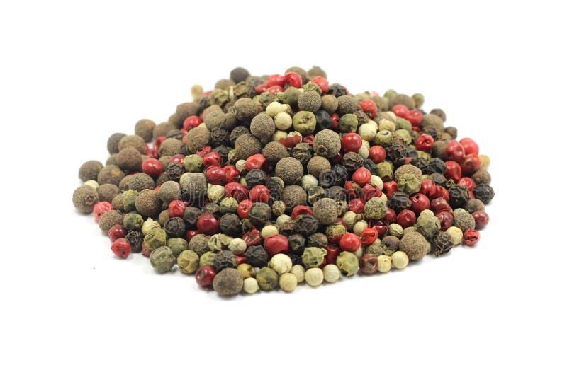 Un puñado de granos de la pimienta imagen de archivo libre de regalías