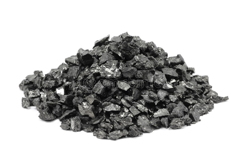 Un puñado de la fracción fina del carbón foto de archivo