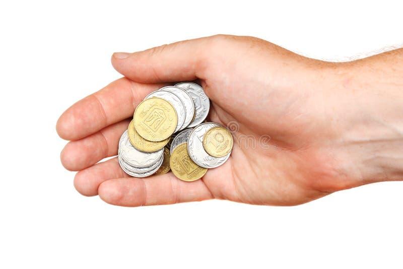 Un puñado de monedas en la palma de una mano, aislada fotos de archivo libres de regalías