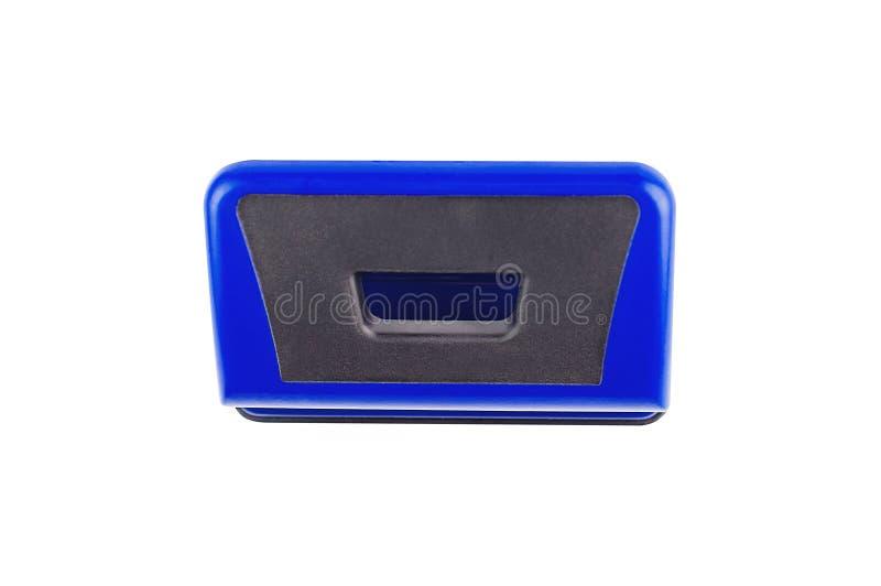 Un puncher de agujero metálico azul aislado en el fondo blanco Visión superior imagenes de archivo