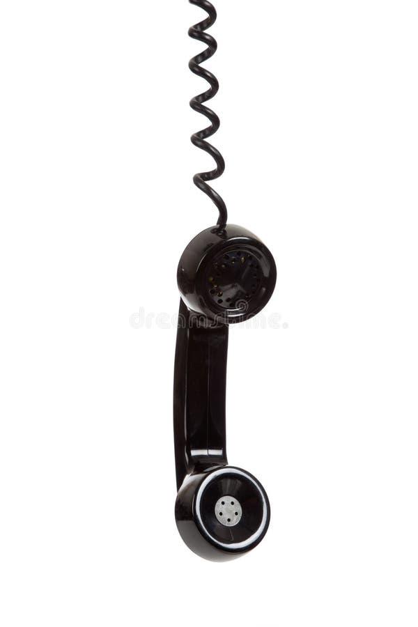 Un receptor de teléfono negro en un fondo blanco imagen de archivo libre de regalías