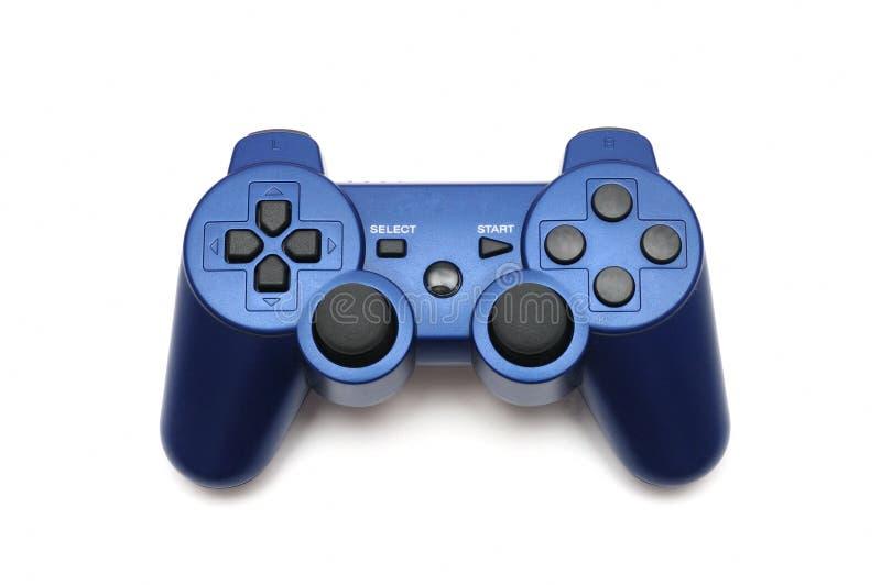 Un regolatore di console senza fili porpora blu della leva di comando del video gioco fotografia stock