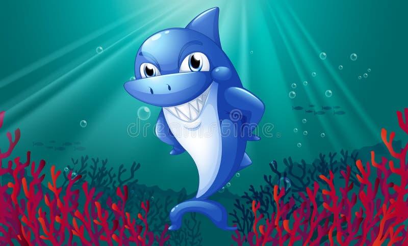 Un requin bleu souriant sous la mer illustration libre de droits