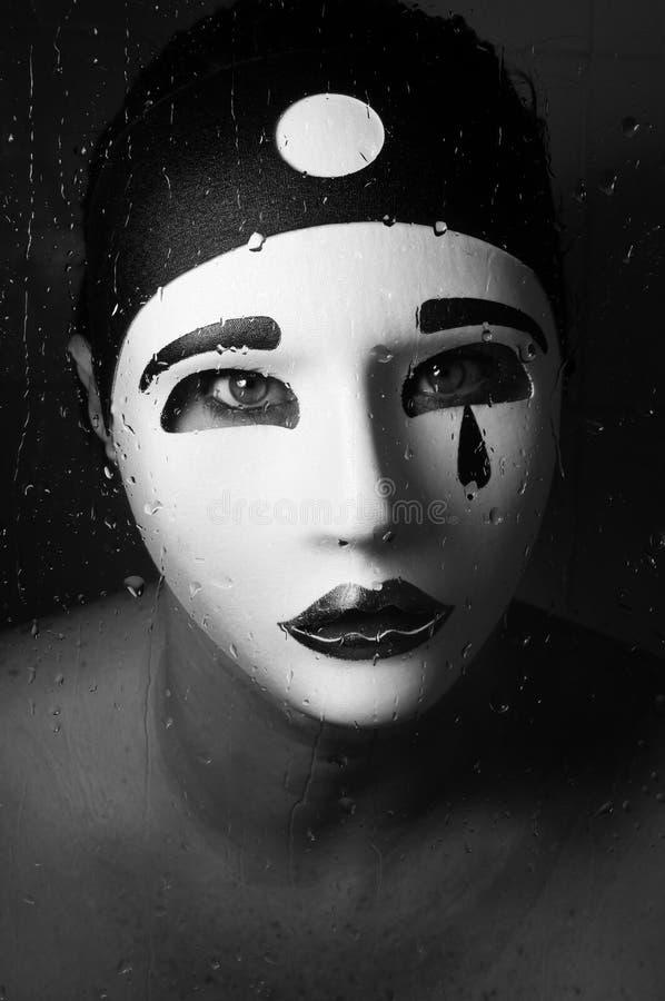 Un retrato con la máscara del pierrot foto de archivo