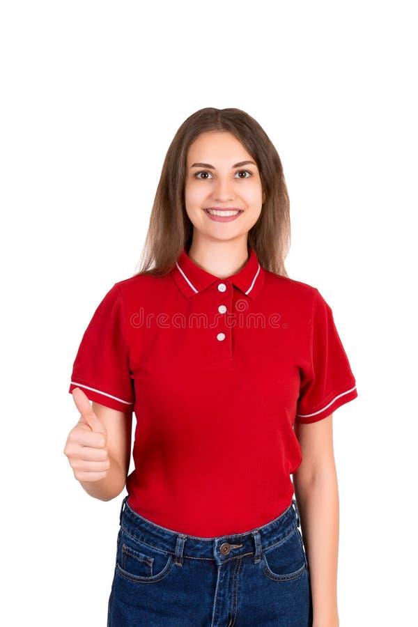 Un retrato del pulgar sonriente bonito de la demostración de la muchacha de la entrega encima de aislado en el fondo blanco imagen de archivo libre de regalías