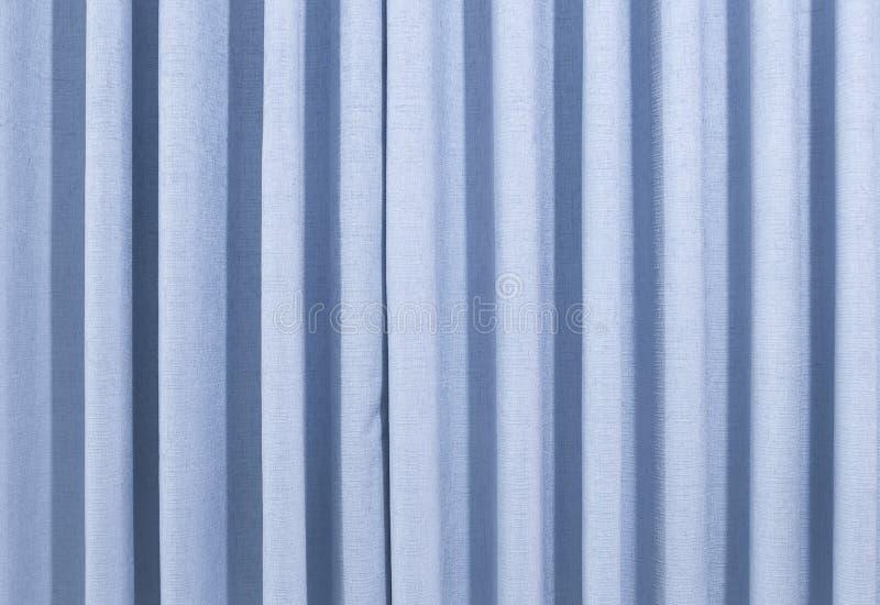 Un rideau bleu image stock