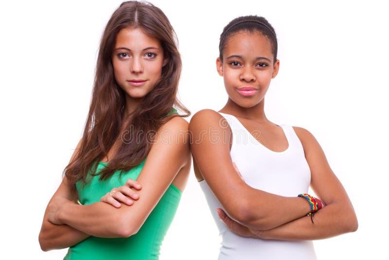 Un ritratto di due ragazze differenti di nazionalità fotografia stock