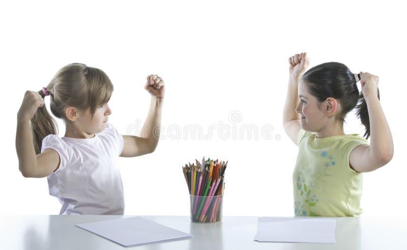 Un ritratto di due scolari immagine stock