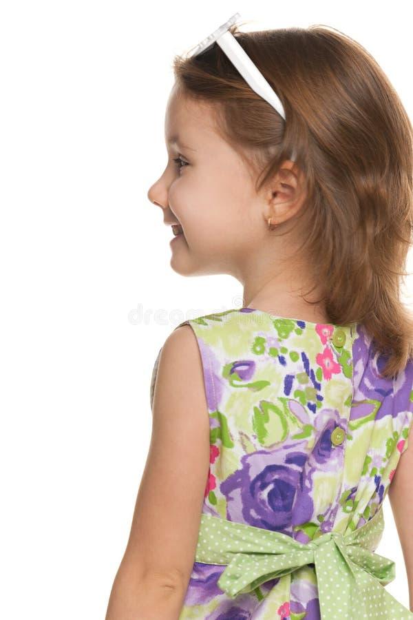 Bambina allegra dalla parte posteriore immagine stock libera da diritti
