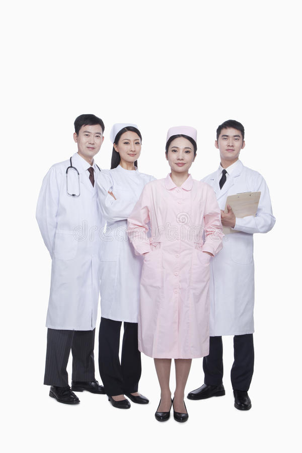 Un ritratto integrale di quattro lavoratori sicuri di sanità, Cina immagine stock