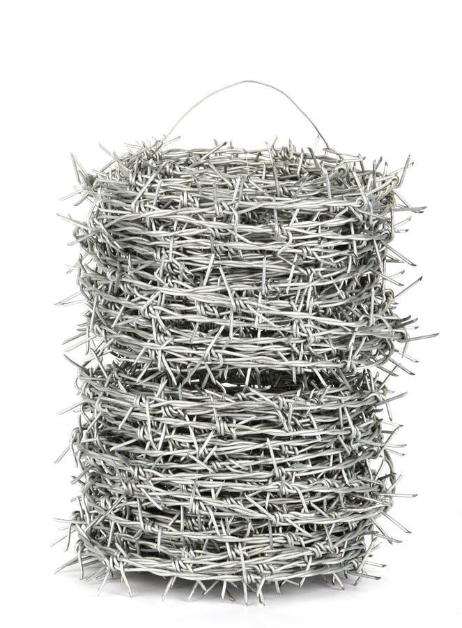 Un rollo del alambre de púas fotos de archivo libres de regalías