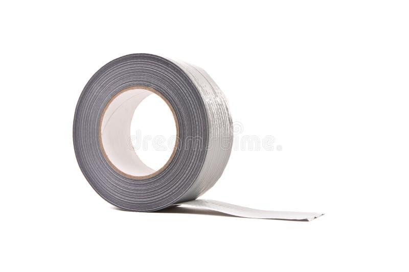 Un rotolo di grey/del nastro condotta dell'argento fotografia stock