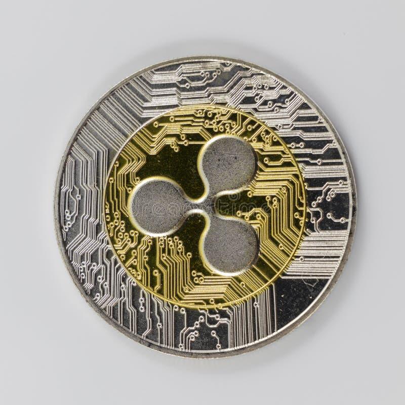 Un símbolo de la ondulación XRP del oro y de la plata foto de archivo libre de regalías
