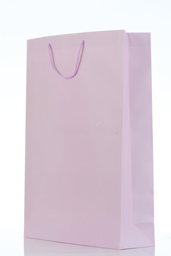 Un sac mauve-clair de cadeau photographie stock libre de droits