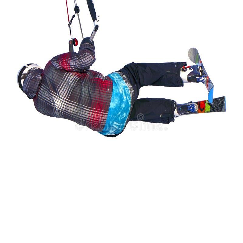 Un salto kiting practicante de la nieve del deportista, aislado en el fondo blanco fotos de archivo
