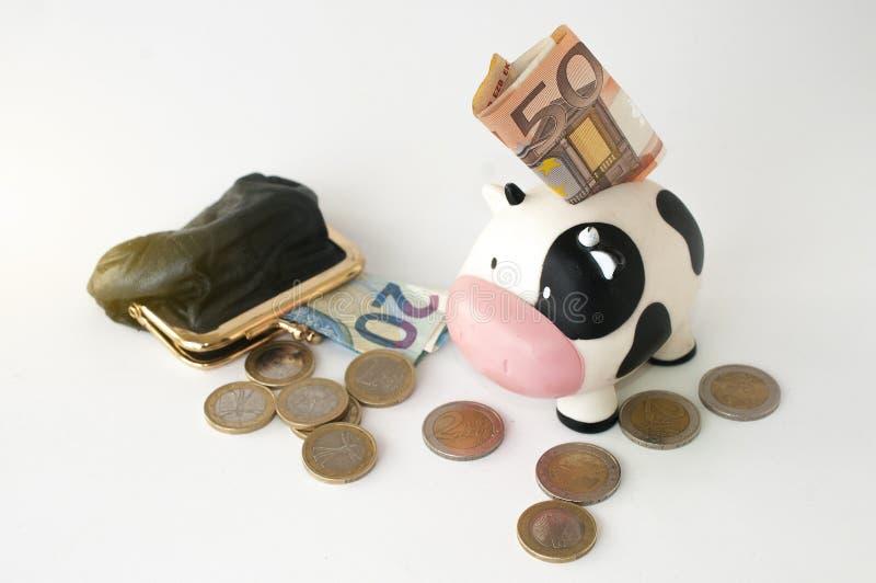 Un salvadanaio con una banconota dentro con una borsa della moneta e una s immagini stock libere da diritti