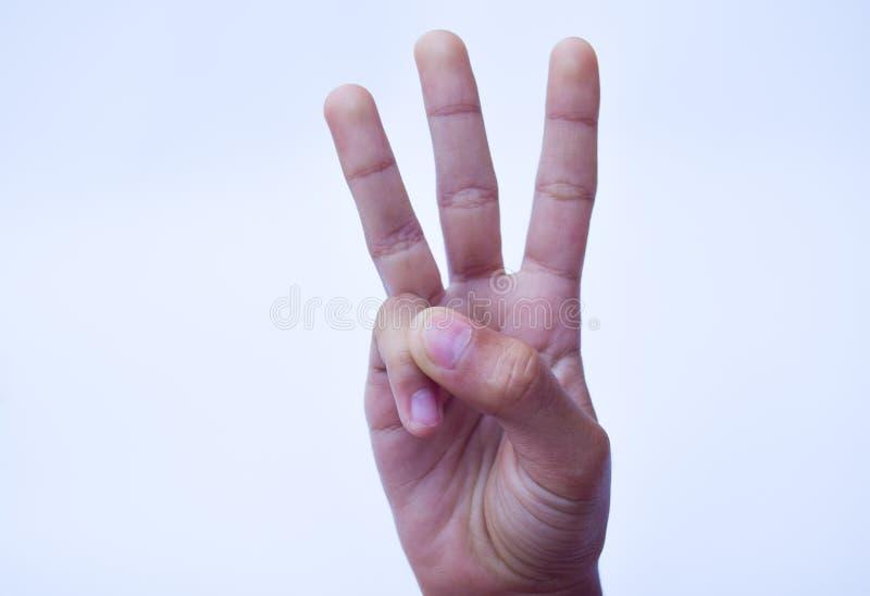 Un segno di tre dita, concetto del segno della mano fotografia stock