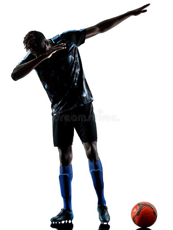 Un silhouet bianco del fondo isolato uomo africano del calciatore immagini stock