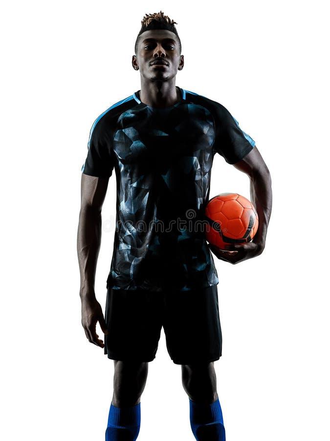 Un silhouet bianco del fondo isolato uomo africano del calciatore fotografie stock libere da diritti