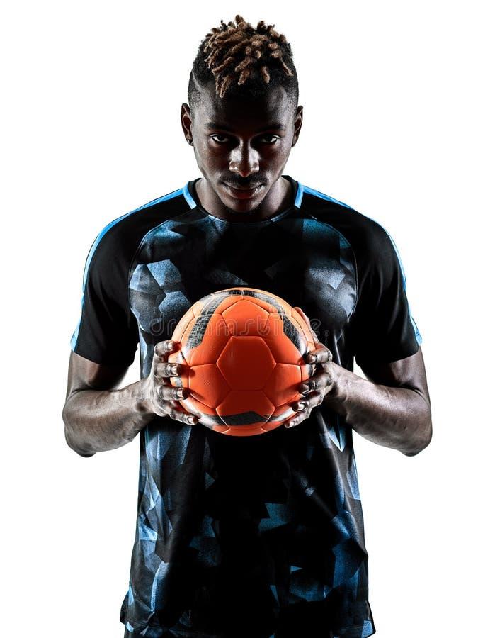 Un silhouet bianco del fondo isolato uomo africano del calciatore fotografia stock