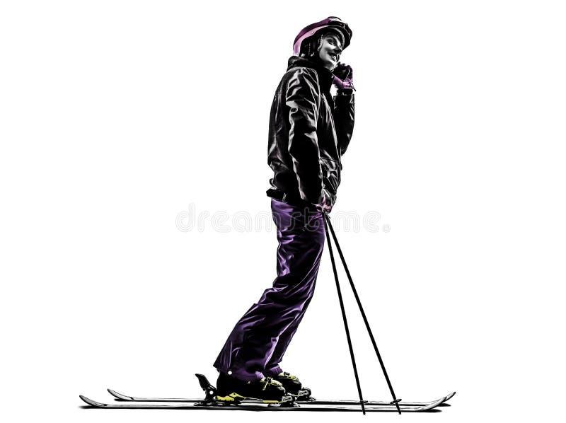 Un ski de skieur de femme sur la silhouette de téléphone image stock