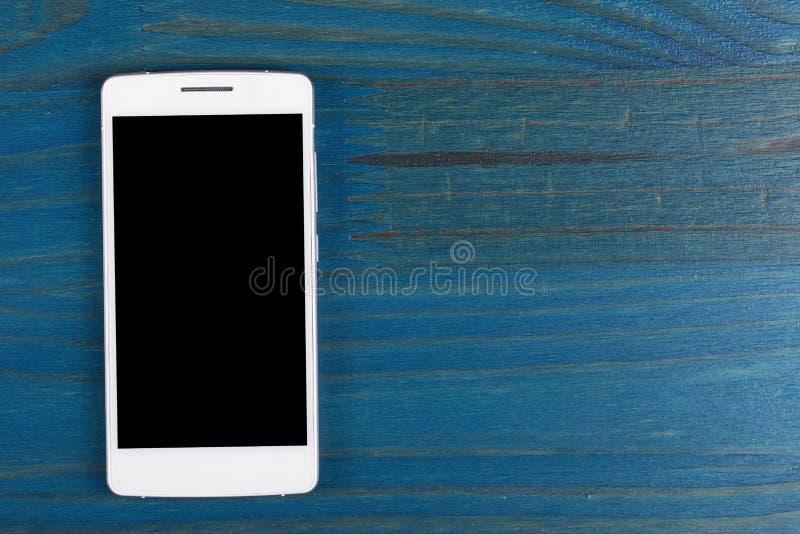 Un smartphone blanc avec le calibre noir d'écran photographie stock libre de droits