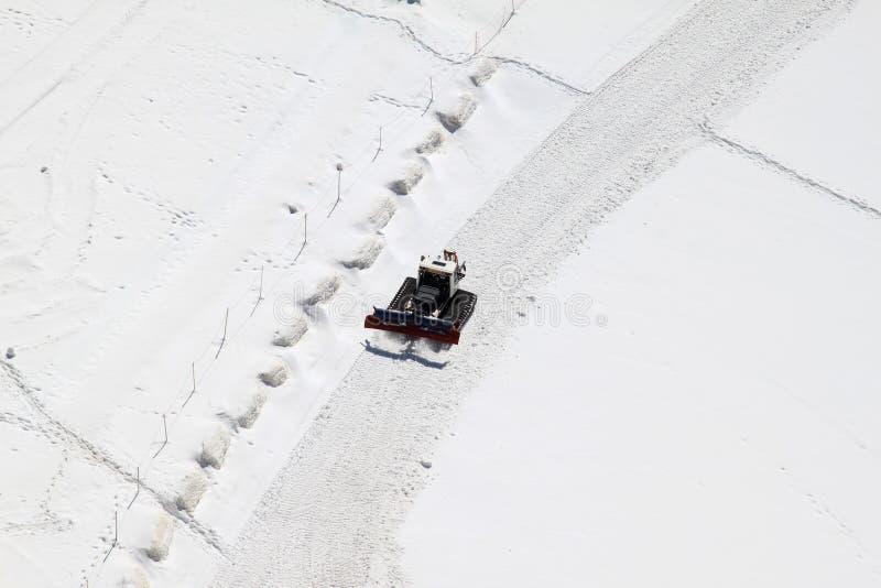 Un snowplow en el Jungfraujoch en Suiza imagen de archivo