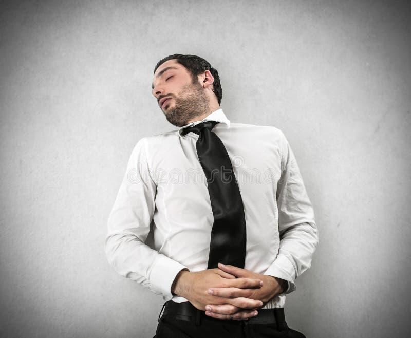 Un sonido del hombre de negocios dormido imagenes de archivo